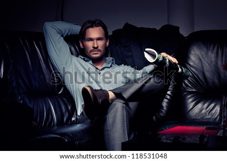 Elegant young handsome man sitting and resting