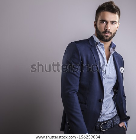 Shutterstock Elegant young handsome man. Studio fashion portrait.