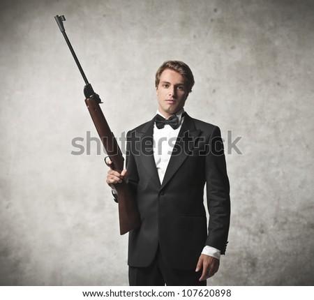 Elegant young killer holding a sniper