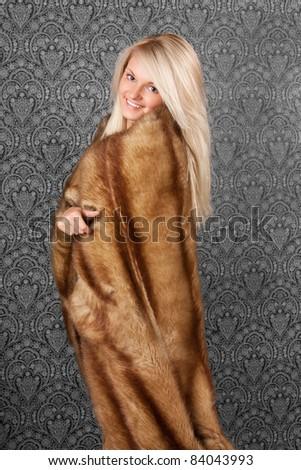 Elegant young lady in a fur coat