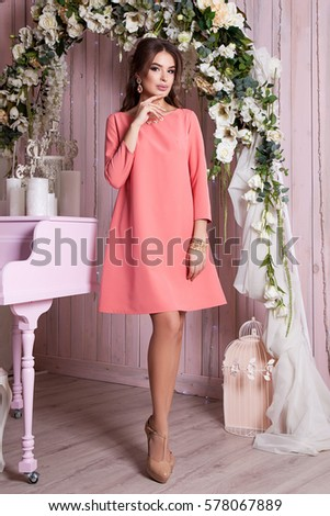 Elegant young woman in evening dress posing in interior. Fashion style portrait of a beautiful girl in interior. #578067889