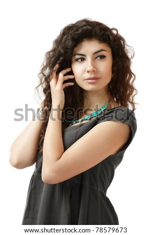Elegant young woman isolated over white looking sidewards