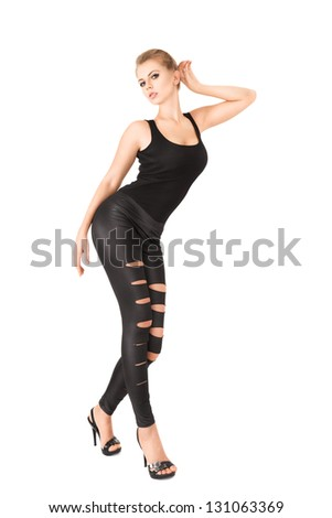 Elegant young woman posing in studio isolated on white background