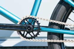 Element BMX-bike: front sprocket bicycle with a connecting rod and a chain. Closeup side view.