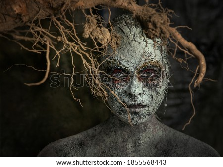 Element earth. The girl in the image of the earth. Fantasy mystical makeup for the image of the earth and man. Girl land.Nature and man.