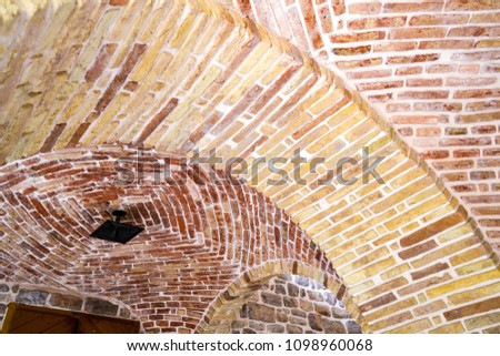 Element of an arch of brick. Arched ceiling. #1098960068