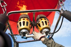 Element of heat inflating of ballon. Propane burners block directing flame into envelope of hot air balloon