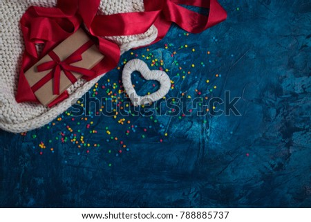 Element of Knitted Fabric, Red Tape, Gift in Kraft Paper with Red Ribbon, White Heart on a blue background with different colors Konfeti Stok fotoğraf ©