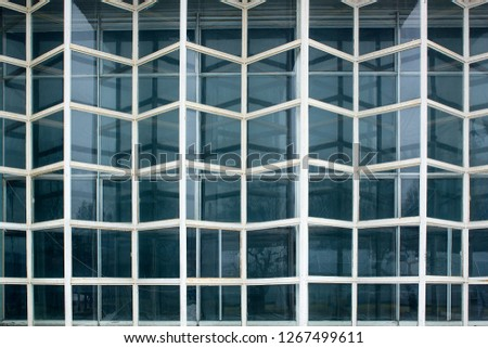 Element of old weathered glass facade, Glass Curtain Facade Wall. Facade Detail. Architecture Abstract Background. #1267499611