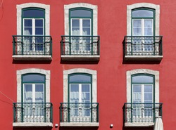 Element of the facade of the house. Old building with a red wall. Lisbon, Portugal