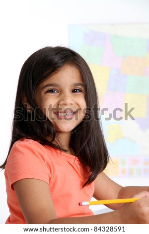 Elementary aged girl in her school classroom
