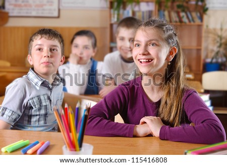 Elementary aged pupils in classroom during lesson