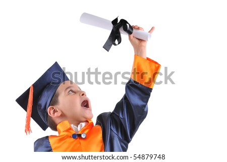 Elementary boy wearing graduation cap and gown holding his diploma