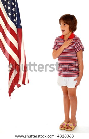 Elementary girl saying the Pledge of Allegiance toward a large American Flag.  Isolated on white.