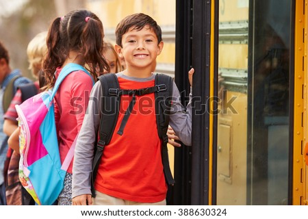 Elementary school boy at the front of the school bus queue
