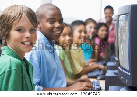 Elementary school computer class looking at camera