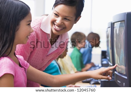 Elementary school computer class with teacher