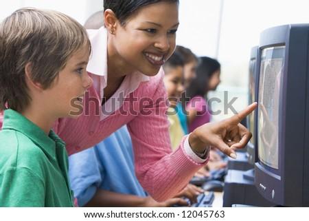 Elementary school computer class with teacher