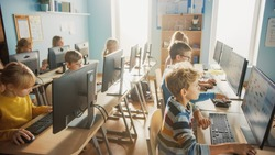 Elementary School Computer Science Classroom: Diverse Group of Little Smart Schoolchildren using Personal Computers, Learn Informatics, Internet Safety, Programming Language for Software Coding