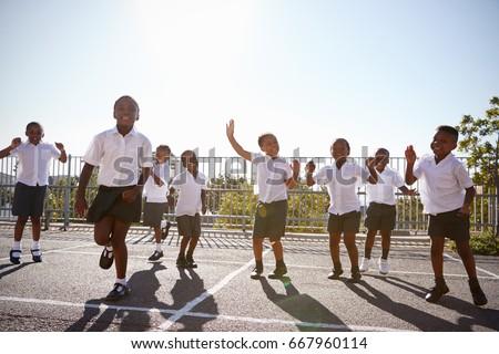 Elementary school kids having fun in school playground