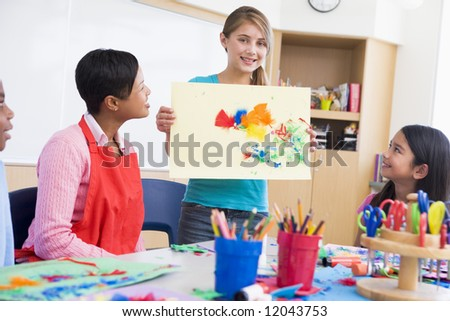 Elementary school pupil talking about picture in art class