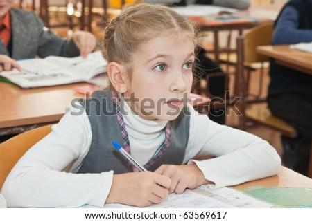 Elementary school. Schoolgirl at a lesson