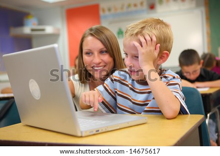 Elementary school student and teacher with laptop