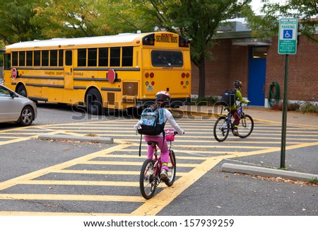 Elementary school students bike to school on International Walk and Bike to School Day