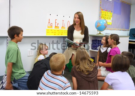 Elementary school teacher reads story to class