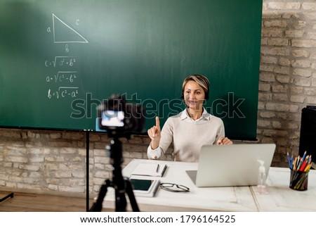 Elementary school teacher teaching math online from the classroom during coronavirus pandemic.
