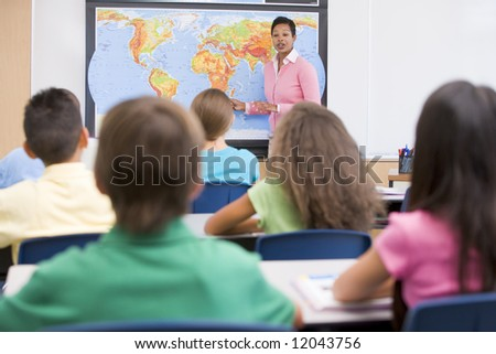 Elementary school teacher with pupils in geography class