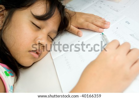 elementary student fall a sleep while doing math homework