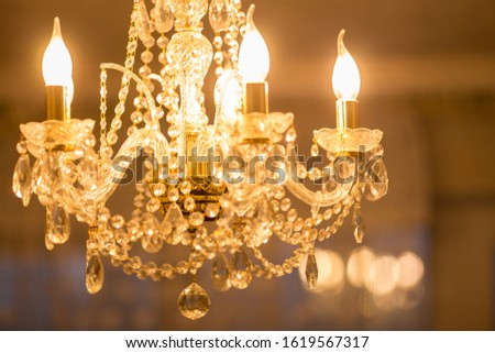 Elements of a crystal chandelier. Chandelier in Baroque style