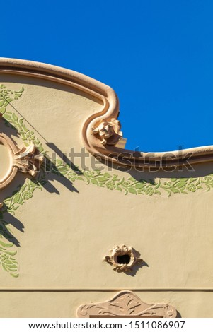 Elements of architectural decoration of buildings, stucco moldings, stucco wall texture, patterns and statues. On the streets in Catalonia, public places. #1511086907