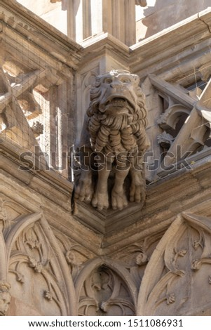Elements of architectural decoration of buildings, stucco moldings, stucco wall texture, patterns and statues. On the streets in Catalonia, public places. #1511086931