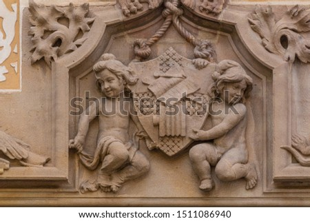 Elements of architectural decoration of buildings, stucco moldings, stucco wall texture, patterns and statues. On the streets in Catalonia, public places. #1511086940