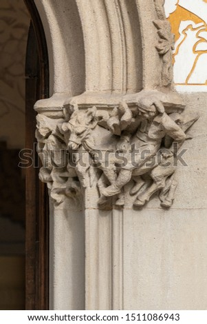 Elements of architectural decoration of buildings, stucco moldings, stucco wall texture, patterns and statues. On the streets in Catalonia, public places. #1511086943