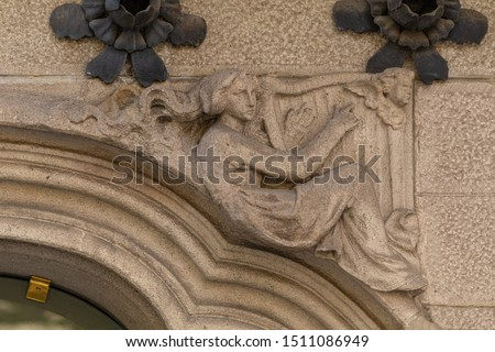 Elements of architectural decoration of buildings, stucco moldings, stucco wall texture, patterns and statues. On the streets in Catalonia, public places. #1511086949