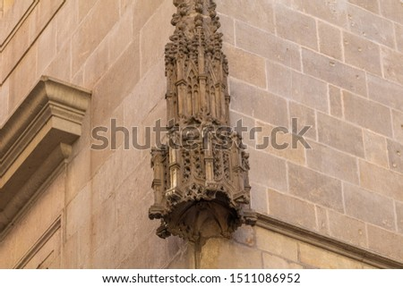 Elements of architectural decoration of buildings, stucco moldings, stucco wall texture, patterns and statues. On the streets in Catalonia, public places. #1511086952