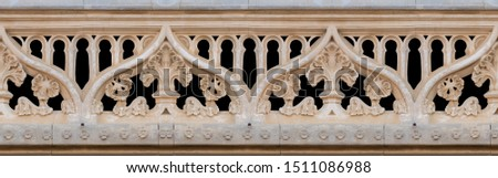 Elements of architectural decoration of buildings, stucco moldings, stucco wall texture, patterns and statues. On the streets in Catalonia, public places. #1511086988