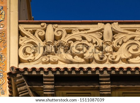 Elements of architectural decoration of buildings, stucco moldings, stucco wall texture, patterns and statues. On the streets in Catalonia, public places. #1511087039