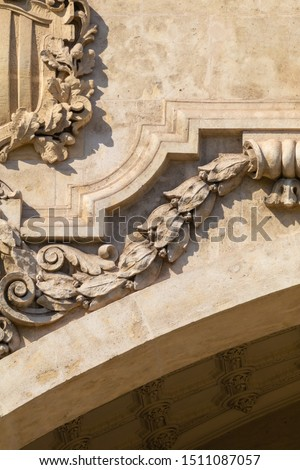 Elements of architectural decoration of buildings, stucco moldings, stucco wall texture, patterns and statues. On the streets in Catalonia, public places. #1511087057