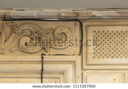 Elements of architectural decoration of buildings, stucco moldings, stucco wall texture, patterns and statues. On the streets in Catalonia, public places. #1511087060
