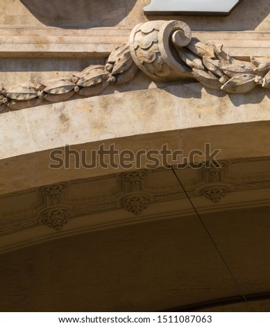 Elements of architectural decoration of buildings, stucco moldings, stucco wall texture, patterns and statues. On the streets in Catalonia, public places. #1511087063
