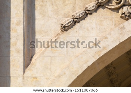 Elements of architectural decoration of buildings, stucco moldings, stucco wall texture, patterns and statues. On the streets in Catalonia, public places. #1511087066