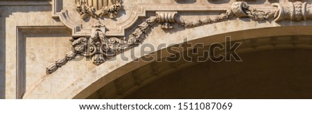Elements of architectural decoration of buildings, stucco moldings, stucco wall texture, patterns and statues. On the streets in Catalonia, public places. #1511087069