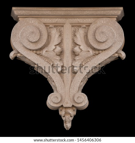 Elements of architectural decorations of buildings, a beam, a bracket under the balcony and a column, plaster patterns and stucco. On the streets in Catalonia, public places. #1456406306