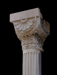 Elements of architectural decorations of buildings, columns and tops, gypsum stucco molding, wall texture and patterns. On the streets in Catalonia, public places.