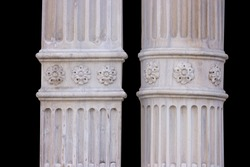 Elements of architectural decorations of buildings, columns and tops, gypsum stucco molding, wall texture and patterns. On the streets in Istanbul, public places.