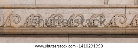 elements of architectural decorations of buildings, moldings and arches on the streets in Catalonia, public places. #1410291950